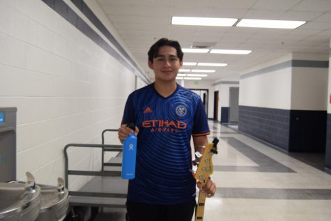 Senior Jeffrey Galan posing with his Hydro Flask