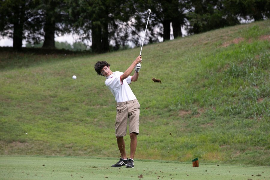 Junior Daniel Gutierrez drives for a hole-in-one.